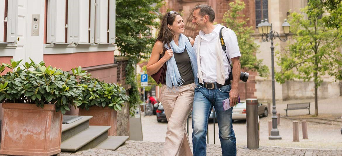 Couple strolling in front of cathedral